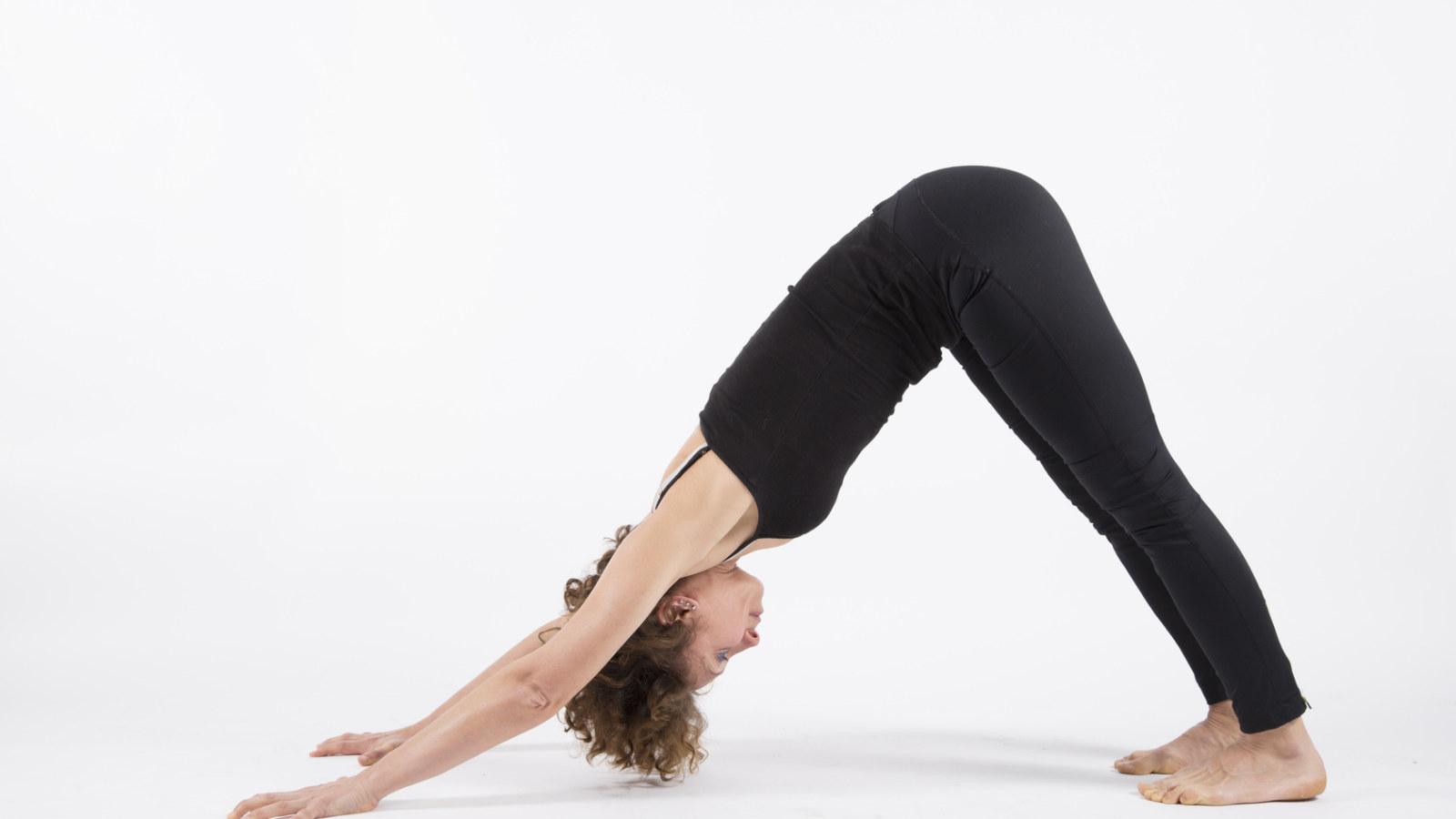 yoga while travelling downward facing dog pose